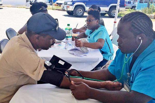 Image: Volunteers being tested for high blood pressure.