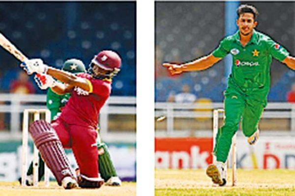 Image: (l-r) West Indies Ervin Lewis and Pakistan Hasan Ali. (Photo: AFP)