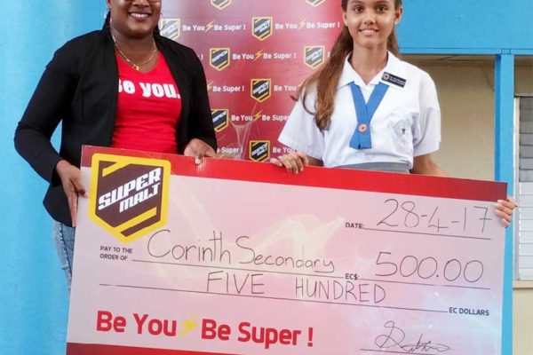 Image: A WLBL official presenting the cash prize to a student of the Corinth Secondary School.