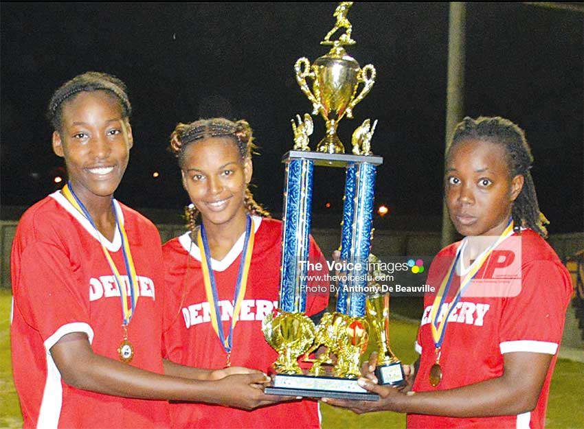 Image: (L-R) Dennery's Ketina Joseph, goal scorer in the 2nd minute, Captain Sylvie Willie and Eliza Marquis, goal scorer in the 8th minute, share in the celebration. . (PHOTO: Anthony De Beauville)