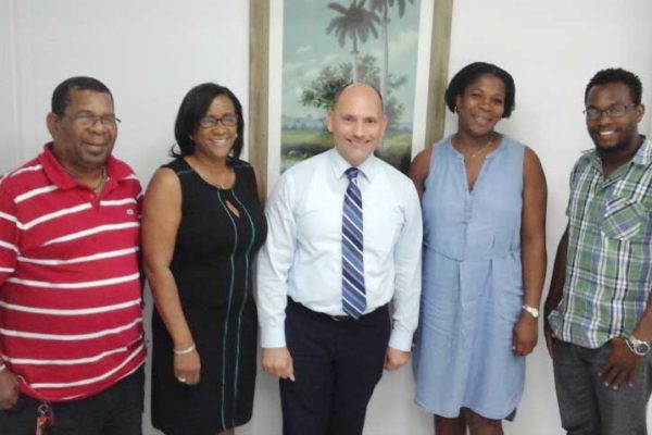 Image: HSA Executive Members with the Ambassador (left to right): Second Vice President Kingsley St. Hill, President Marlene Alexander, Cuban Ambassador Jorge Soberon, Treasurer Liza Fontenelle and Public Relations Director Selva Wilson.