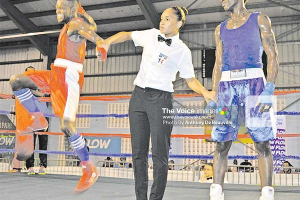 Image: Kareem Boyce jumps to joy following his victory against Nelon Cyrus of Grenada. (PHOTO: Anthony De Beauville)
