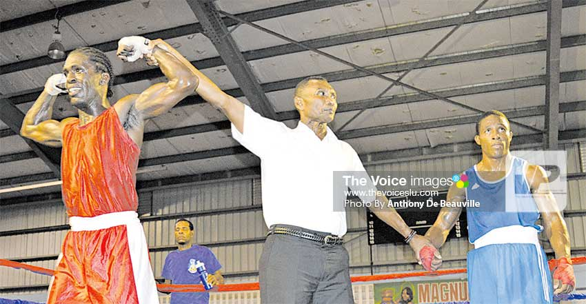 Image: Saint Lucia's Lyndell Marcellin flexes his muscles after he was declared winner over Charles Leatham of Dominica.  (PHOTO: Anthony De Beauville)