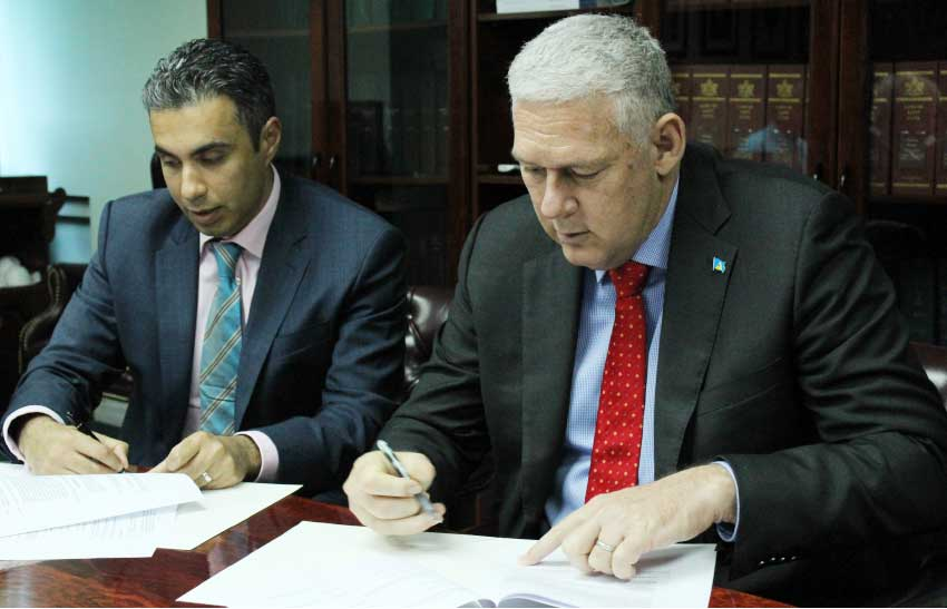 Image: Prime Minister Allen Chastanet and Mohammed Asaria signing the definitive agreement. [PHOTO: PhotoMike]