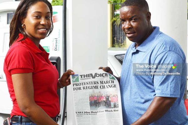 Image: (l-r) RUBIS Marketing Assistant Chriselda Norbal presenting a copy of The VOICE to a customer. (Photo: Anthony De Beauville)