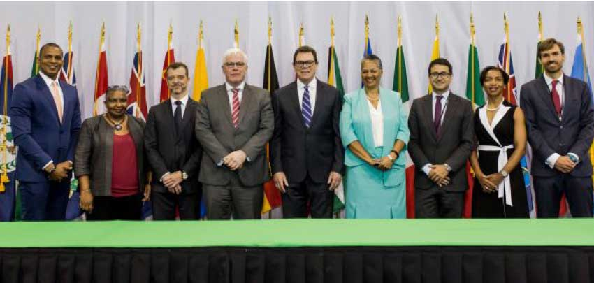 Image: Representatives from CDB and EIB during the signing ceremony for the Climate Action Framework Loan II.