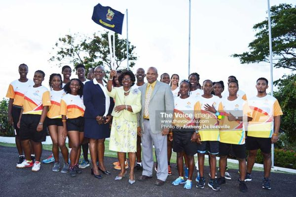 Image: Governor General Dame PearletteLouisy holds the QBR aloft. Also in photo are Acting Prime Minister Ezechiel Joseph, Regional Vice President of the Commonwealth Games, Fortuna Belrose, and participating athletes. (Photo: Anthony De Beauville)