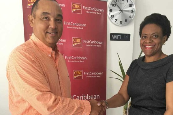 Image of Mario Reyes and Ladesa James-Williams seal the deal.