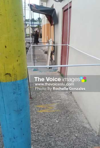 Image: Sidewalk cluttered with vending booths. [PHOTO: Rochelle Gonzales]