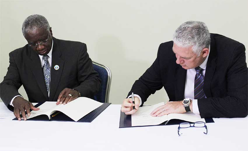 Image: Barbados Prime Minister Freundel Stuart (l) and Saint Lucia's Prime Minister Allen Chastanet sign an agreement on the delimitation of the maritime boundary between Barbados and Saint Lucia.