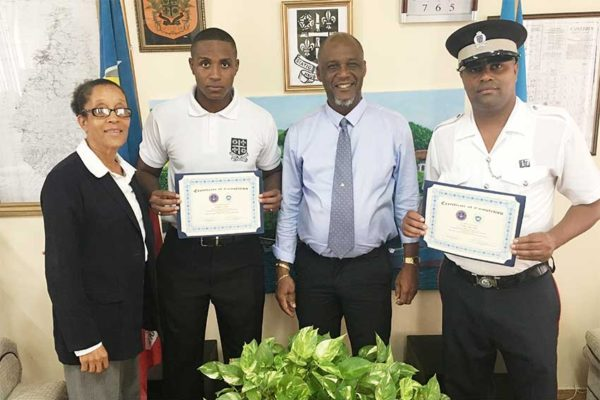 Image: (From left to right) -- CEO Anselma Calderon, Officer Joshua Lubin, Mayor Peterson D. Francis, and Sergeant YoneCamchon.