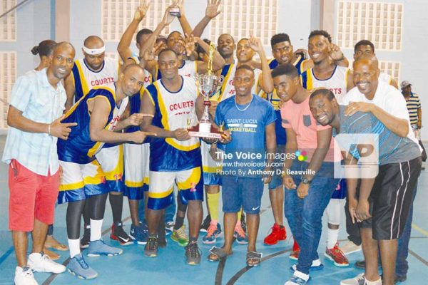 Image: Courts Jets celebrate their 5th consecutive championship victory. (PHOTO: Anthony De Beauville)