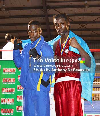 Image: Saint Lucia's gold medal winners Nathan Ferrari and Lyndell Marcellin draped with the national flag. (Photo: Anthony De Beauville)