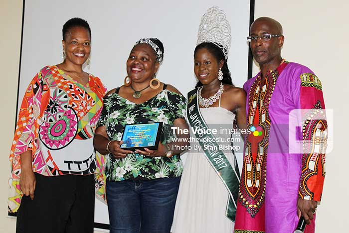 "Image: Tet Paul proprietor Maureen Fontenelle, (second from left), flanked by Dr. Walls (far left), 2017 Jaycees Queen Ayana Dorsette of Antigua and Barbuda, and Ed ""Bro Umoja"" Herman."