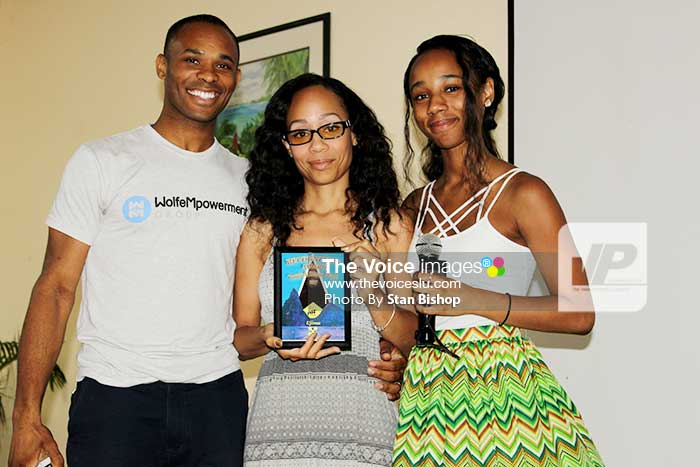 Image of Fifteen-year-old filmmaker Aniya Wolfe, (centre), and her parents.