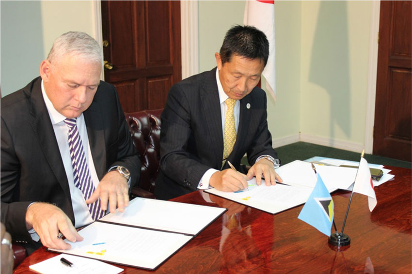 img: Prime Minister Allen Chastanet and Japan's Ambassador to St. Lucia H.E. Mitsuhiko Okada signing the agreement, which is said to be one of the most ambitious of aid provided by Japan to St. Lucia.