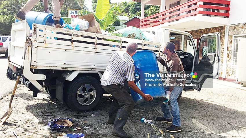 Image of Residents cleaning up their community yesterday. [PHOTO: Rochelle Gonzales]