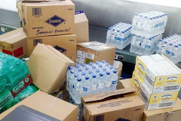 Image - Bottled water, non-perishable food items and other supplies being shipped to Turks and Caicos.