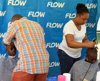 Image: Boys were able to get free haircuts and girls got their hair braided at the Flow back-to-school fair.