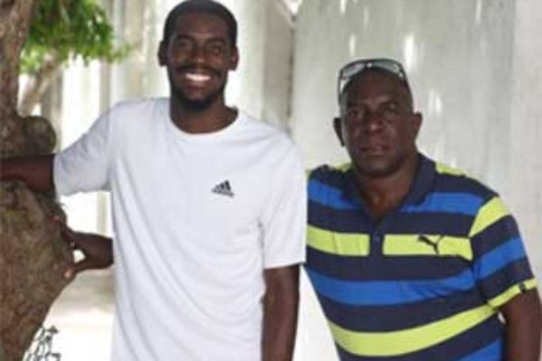 Image: Coach Xavier Samuel (R) with Kyron McMaster who has a world-leading time in the 400-metres hurdles this year.