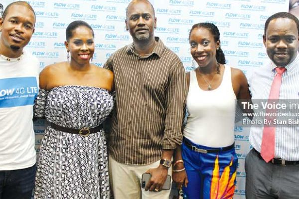 Image - Flow's Terry Finisterre, Chris Williams and Anselm Mathurin with collateral partner Latoya Lewis of Glamour Art by Toya and brand ambassador Taribba do Nascimento of meme bete bags at Thursday evening's media launch of Flow's 4G LTE at its Baywalk Shopping Mall outlet. (PHOTO: Stan Bishop)