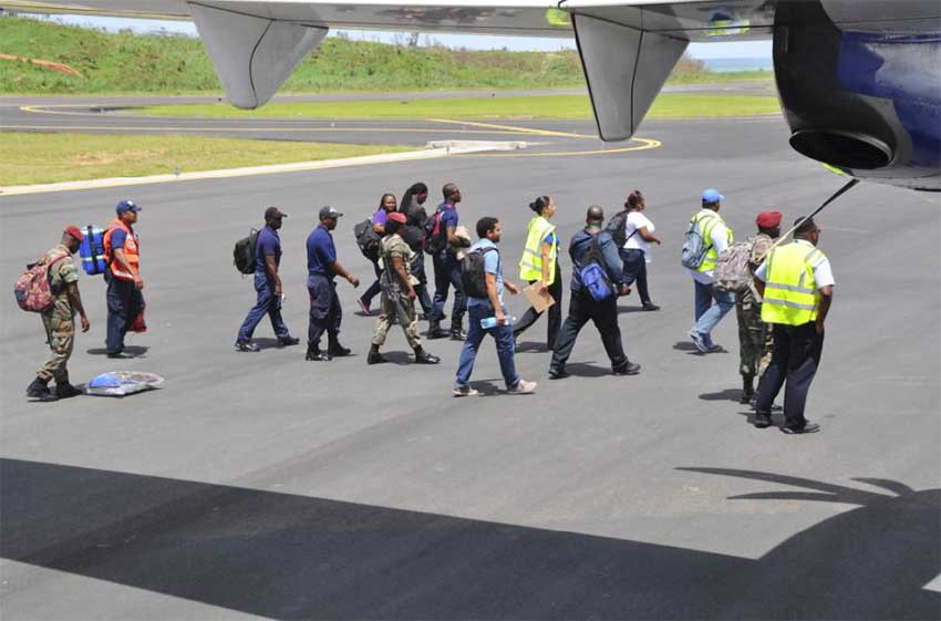 Image: Members of Antigua & Barbuda Fire Service and The Antigua and Barbuda Defence Force.