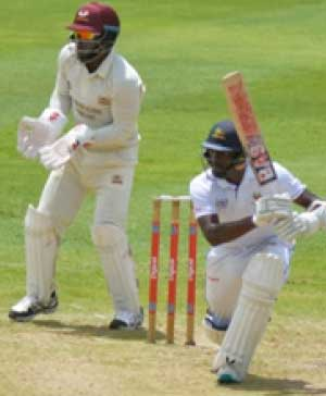 Image of Windies A captain Shamarh Brooks drives through the offside