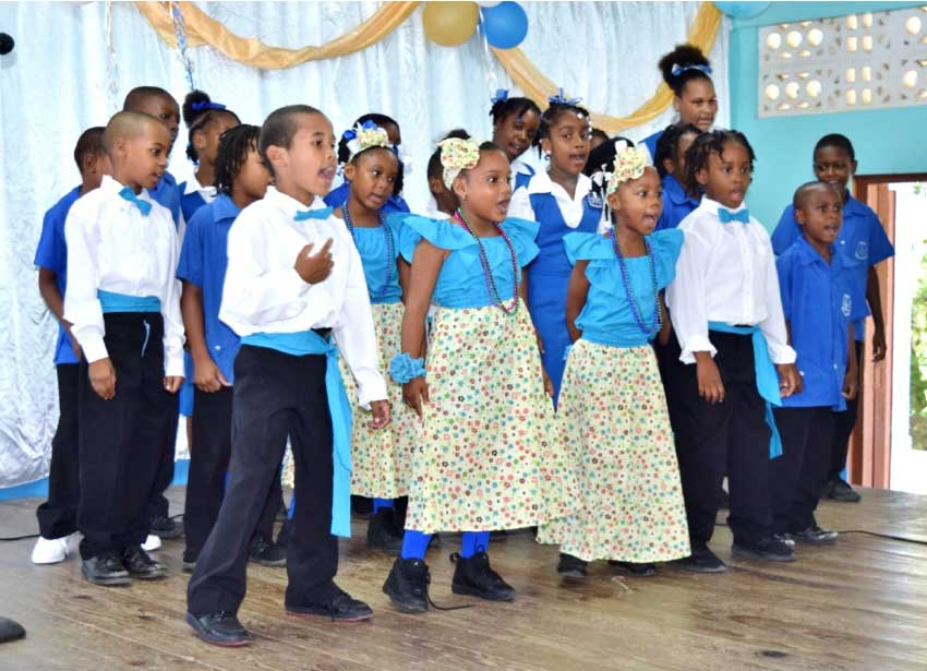 Image of The Dugard RC Combined School Choir in full voice.