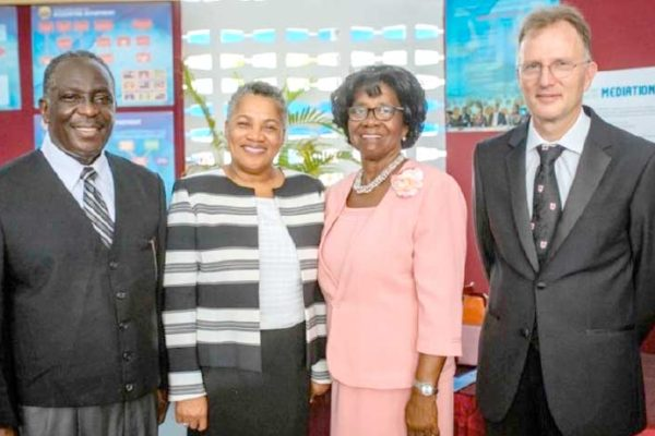 Pictured from L-R are: His Lordship the Hon. Justice K. Neville Adderley (High Court Judge (Ag), TVI Commercial Division); Her Ladyship the Hon. Dame Janice M. Pereira DBE, Chief Justice; Her Excellency Dame Calliopa Pearlette Louisy, Governor General of Saint Lucia; and His Lordship the Hon. Justice Gerard Wallbank, (High Court Judge (Ag), TVI Commercial Division).