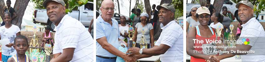 Image: (L-R) Peter Alphonse (youngest male), Peter Kent (oldest male) and Maudlin Coates (oldest female) receiving their trophy from Pastor Lennox Maxius. (Photo: Anthony De Beauville)