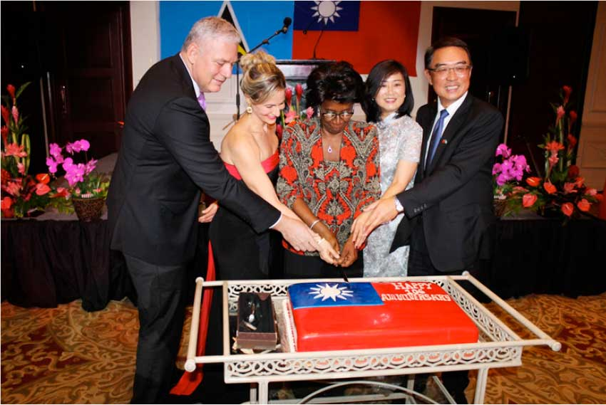 Image: Prime Minister Chastanet and wife, Raquael, join Dame Pearlette Louisy and Taiwanese Ambassador Shen and his wife, Ling-hon, in cutting the cake at the recent reception in honour of Taiwan's 106th National Day.