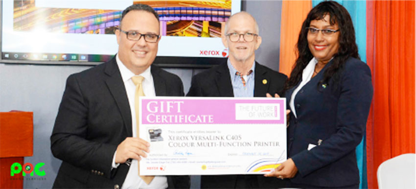 Image: Xerox Future Of Work Event Grand Prize Winner, Gillian Polius – Branch Administrator, Sagicor General Insurance Inc., receives her prize from Joel Mendoza – Country Manager, Xerox Distributor Group, left, and Anthony Bergasse, Managing Director, J. E. Bergasse & Company Ltd. (right).