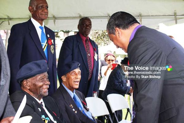 Image of Acting Prime Minister, Guy Joseph, greeting veterans and others at the ceremony.