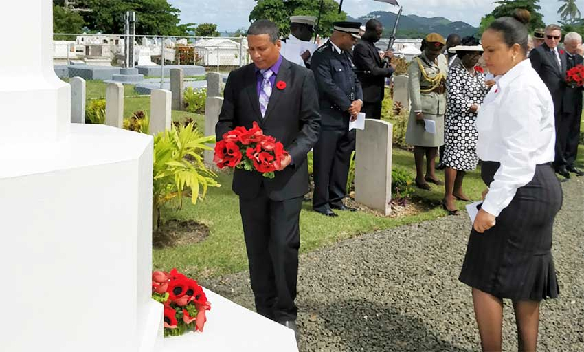 Image: Acting Prime Minister, Guy Joseph, lays a wreath at Choc Cemetery.