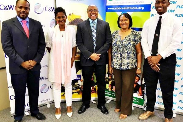 Image: (From left to right): Anselm Mathurin (Flow), Sabina Valmont (Southern Business Association), Titus Preville (Department of Commerce), Paula James (Manufacturers Association), and Wilton Jeremie.