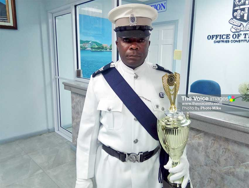 Image of Aubrey St. Juste of the Constabulary with his trophy for winning the Employee of the Year Award. (PhotoMIke)