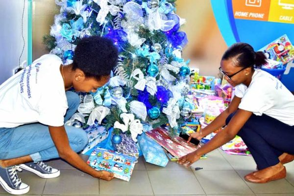 Image: Flow colleagues got Mission Day underway by bringing in books and toys for the children of Dominica.