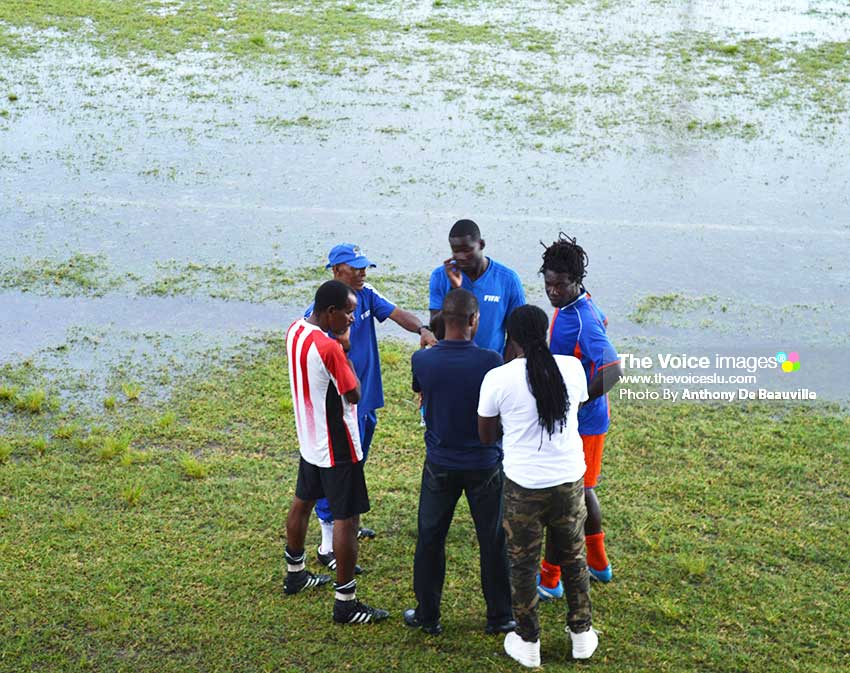 Image: Head of SLFA Referees committee Timothy Joseph (with cap on) and match officials speaking to representatives of Allez and Black Panthers