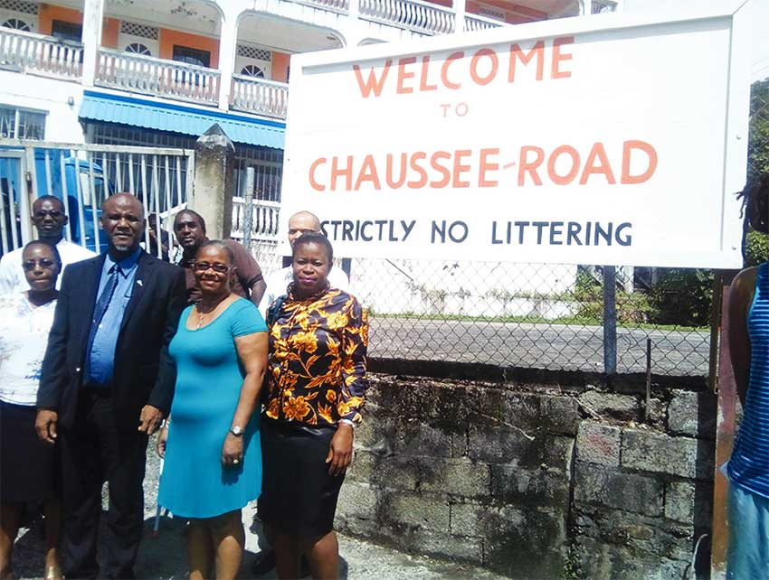 Image of Mayor Francis and members of CROBA in front the billboard placed at a spot where garbage once dominated.