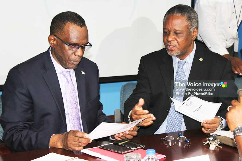 Image: Opposition Leader Pierre (left) with National Security Minister Francis in discussion just before the commencement of yesterday's symposium. (PhotoMike)