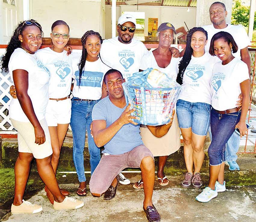 Image: Team Flow presented Christmas hampers to needy members of the Gros Islet community.