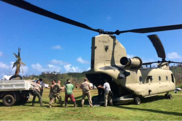 Image: The United States Government team members offload supplies in Dominica.
