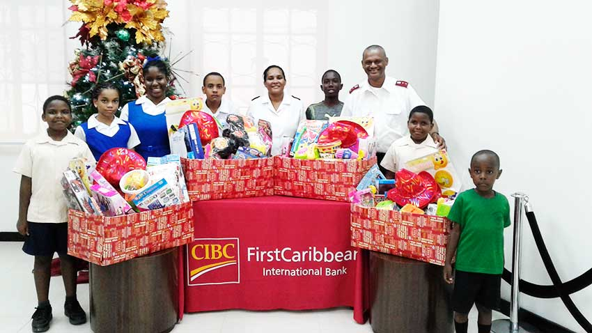 Image of Captain Mitchel and another Salvation Army representative and students.