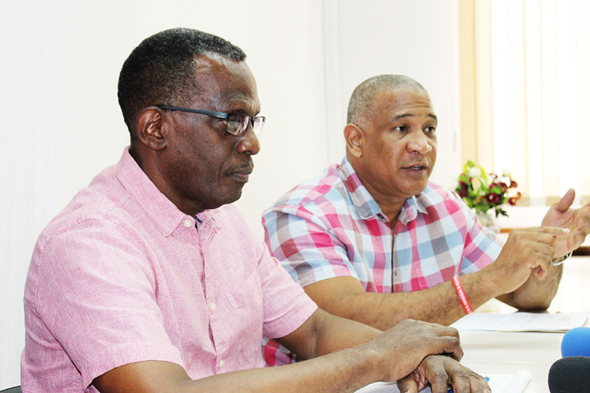 Image of Dr.Hilaire and Pierre at yesterday's press conference. [PHOTO: PhotoMike]