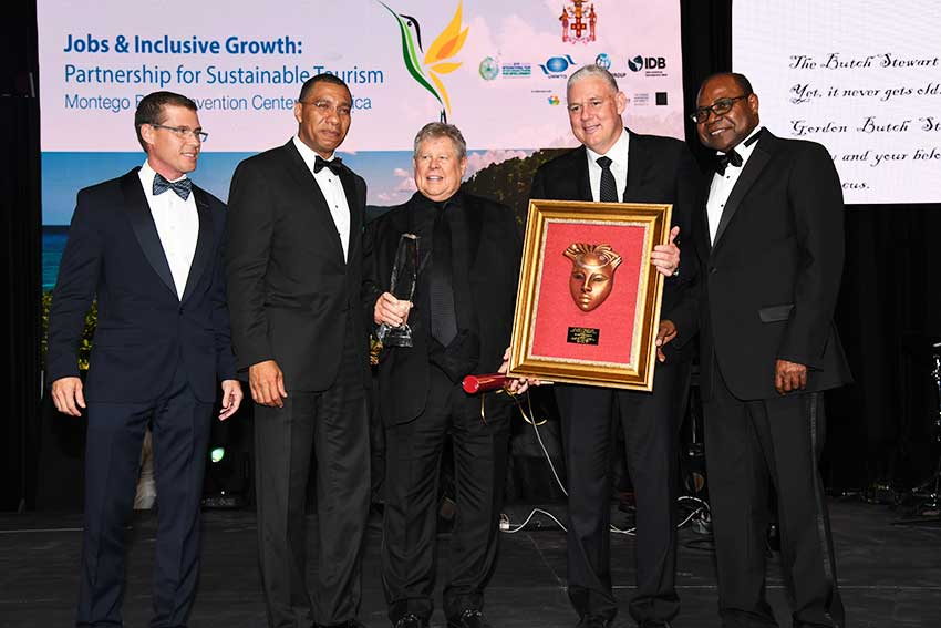 Image: Gordon 'Butch' Stewart and Prime Ministers Allen Chastanet and Andrew Holness, among others, at the ceremony.