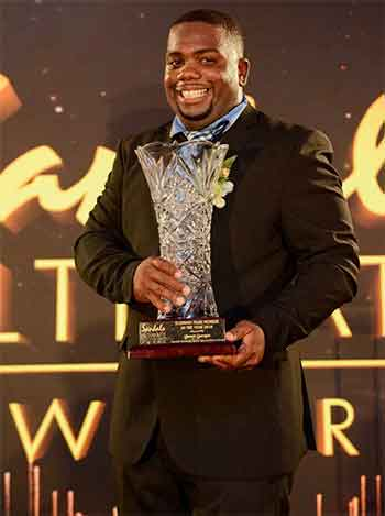 Image: The life of the party -- Jamer 'Captain Neil' Georges, a playmaker from Sandals Grande St. Lucian Beach Resort & Spa Entertainment Department -- Winner Ultimate Team Member of The Year.