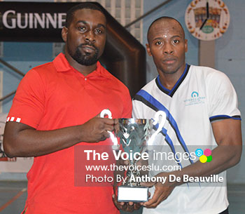 Image of Marketing Manager of KFC Jamal Cyril presenting the second place trophy to Windjammer captain Tyson Fedee. (Photo: Anthony De Beauville)