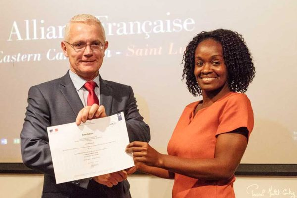 Image: Philippe Ardanaz, French Ambassador in Saint Lucia, presents a certificate to one of the course participants (right).