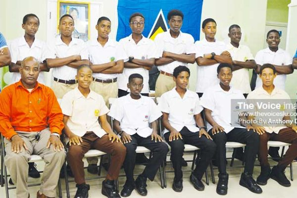 Image: A picture moment for Team Saint Lucia with acting Youth and Sports Director Patrick Mathurin (first from left, front row). (PHOTO: Anthony De Beauville)