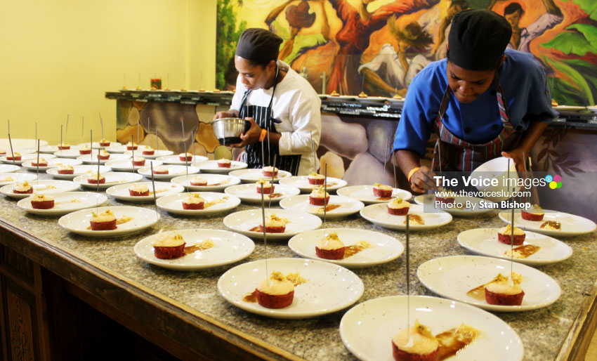 Image of Local chefs working diligently on their preparation at last Saturday's Celebrity Chef Dinner. [PHOTO: Stan Bishop]